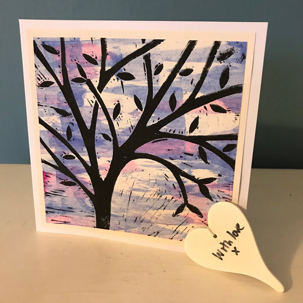 A tree with a blue/pink sky.  This lino cut is handprinted.  Blank inside for any occasion.