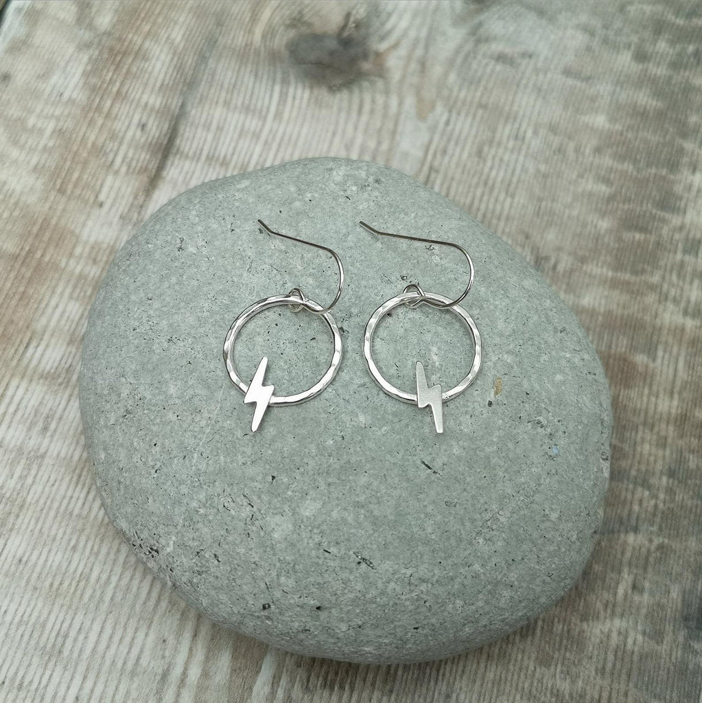 Glass Designs Jewellery By Jo silver dangly earrings with circles and small lightening shapes.