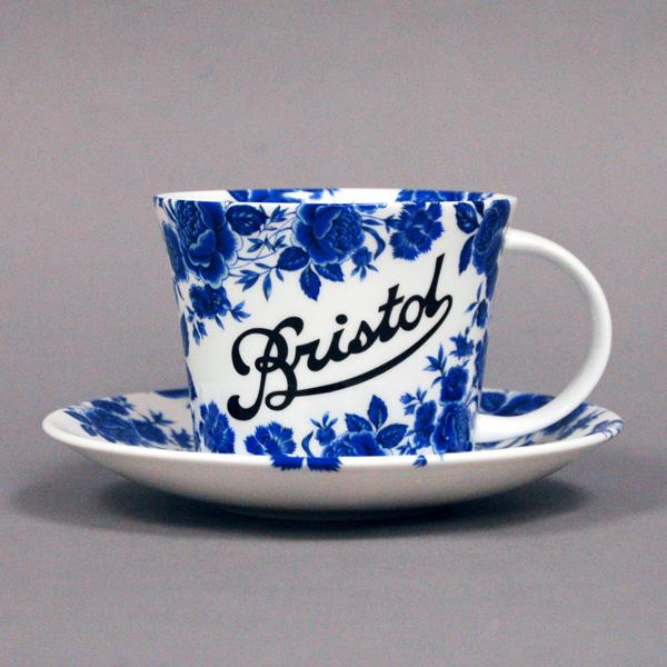 Stokes Croft China Breakfast cup and saucer, with the blue rose and the classic Bristol scroll.  Individually deorated in Bristol.