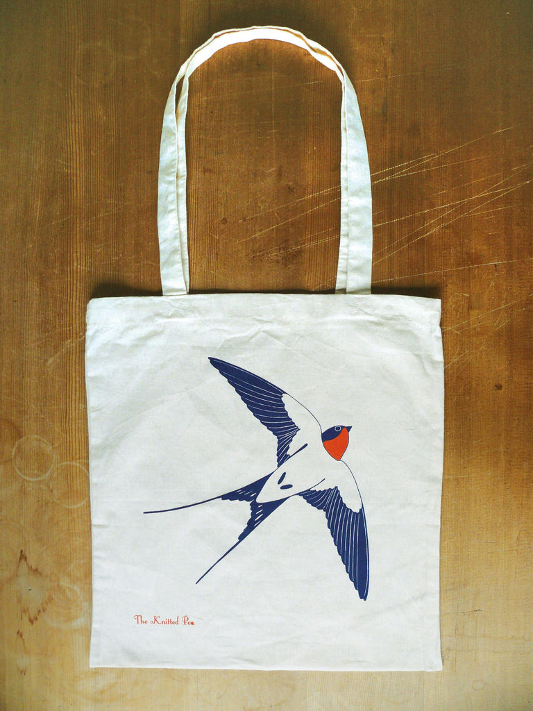 100 % cotton tote bag with a flying swallow printed on one side. Handmade in Bristol.