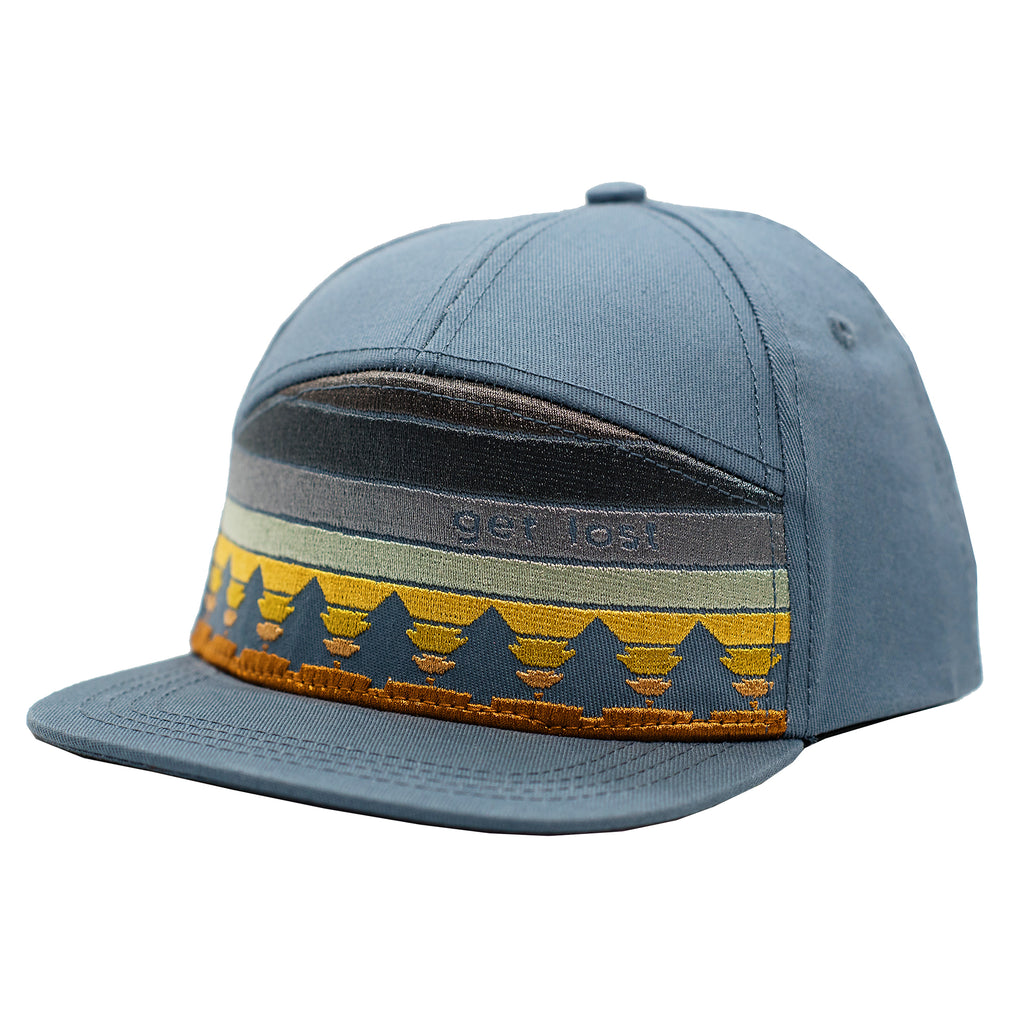 Get lost embroidered woodsy kids hat for hikers, outdoor-lovers, and just cool kids. Subtle sunset design with pine trees on a slate blue flat brim children's cap.