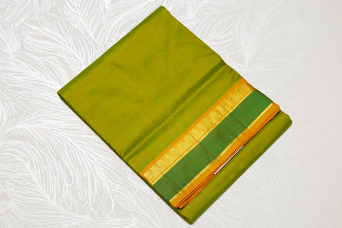 17115  9 Yards Pure Silk medium border contrast Pallu Maanthulir with green border mustard pallu