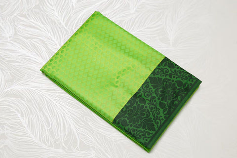 30106 Semi Silk Polyester Mix thread border emboss pista green with black border and pallu