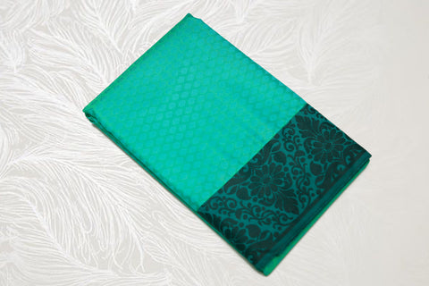 30113 Semi Silk Polyester Mix thread border emboss Rexona Green with black border and pallu