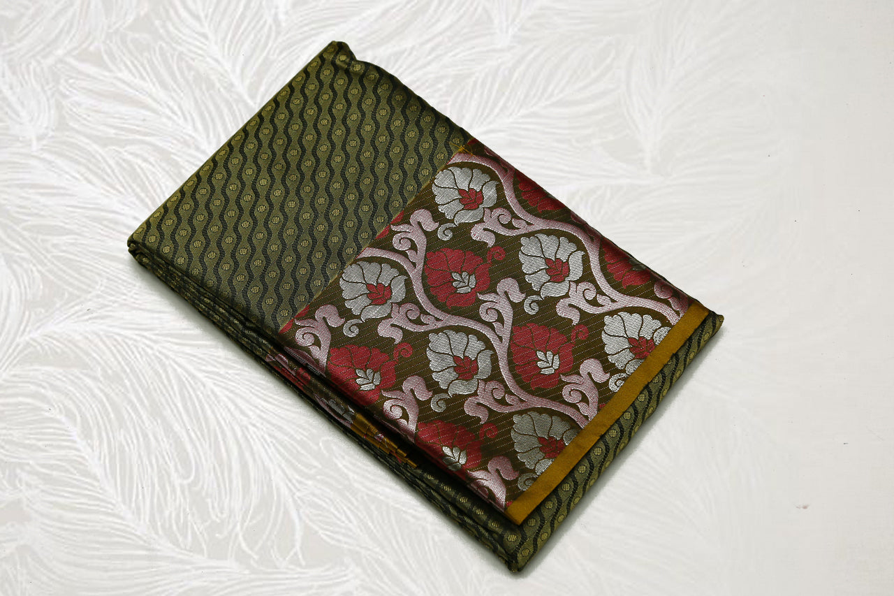 30152 Semi Silk Polyester Mix big white Zari and thread border emboss Elaichi green short with light brown border and silver pallu