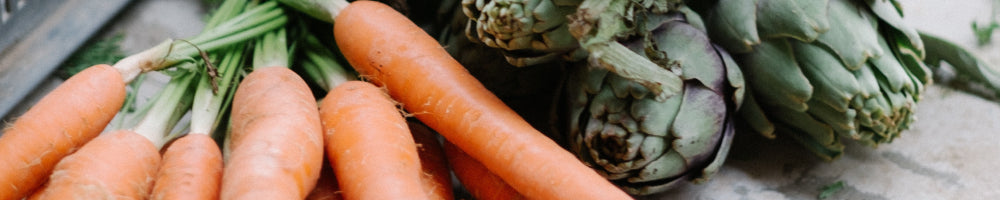 An image of couple of carrots and some vegetables