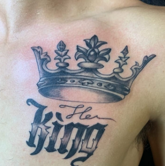 Optimistic Male Crown Tattoo Design on Chest
