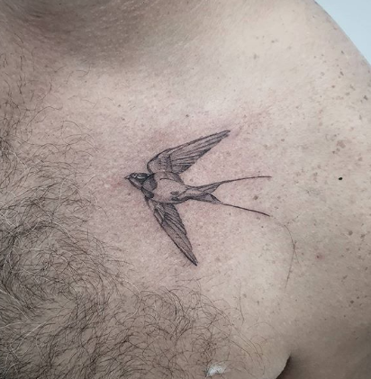 swallow chest tattoo
