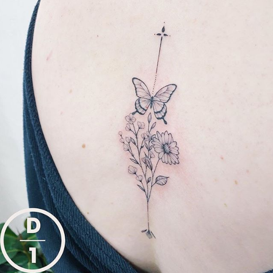 flower and butterfly spine tattoo