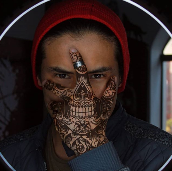 hand face skull tattoo