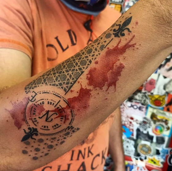 compass tattoo with fake blood stain