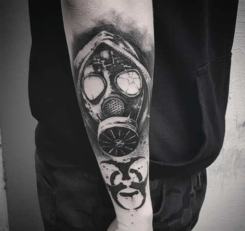 gas mask tattoo design on the forearm