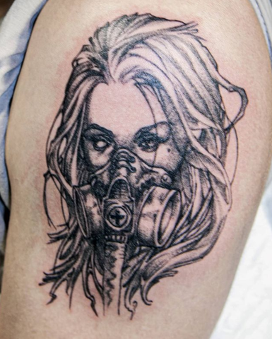 gas mask tattoo design on the arm