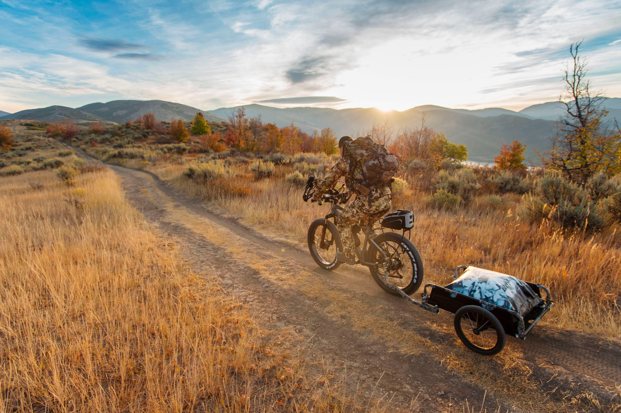 Biking down a dirt trail on the PWR dually AWD E-bike with Traction Control