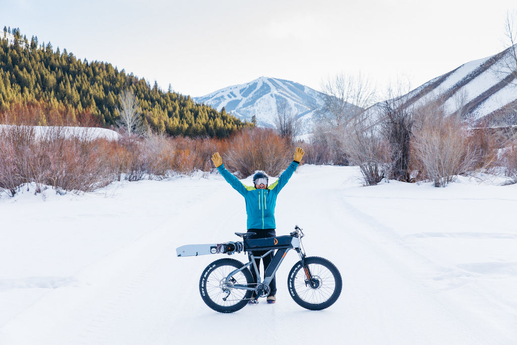 man with PWR Dually bike in the snow