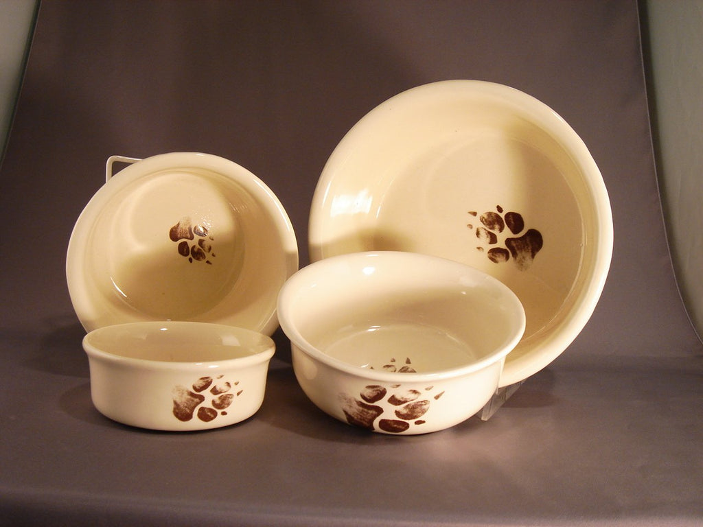 Ceramic Grubby Paws feeding bowls for dogs - 4 sizes displayed