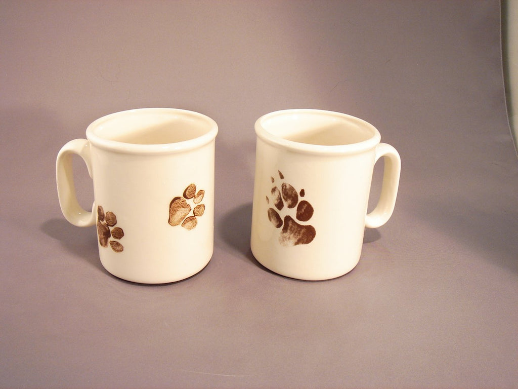 Hand made ceramic mugs, white with either dog or cat paw prints