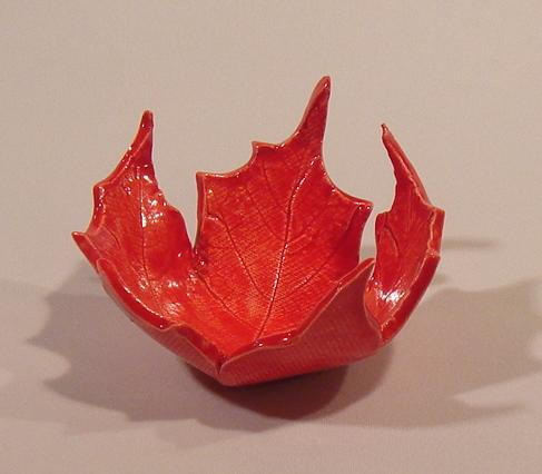 Red ceramic maple leaf bowl