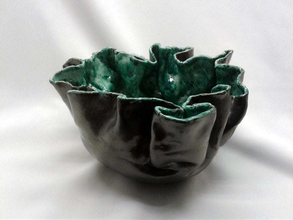 Large hand built ceramic bowl, antique silver glaze outside and green inside