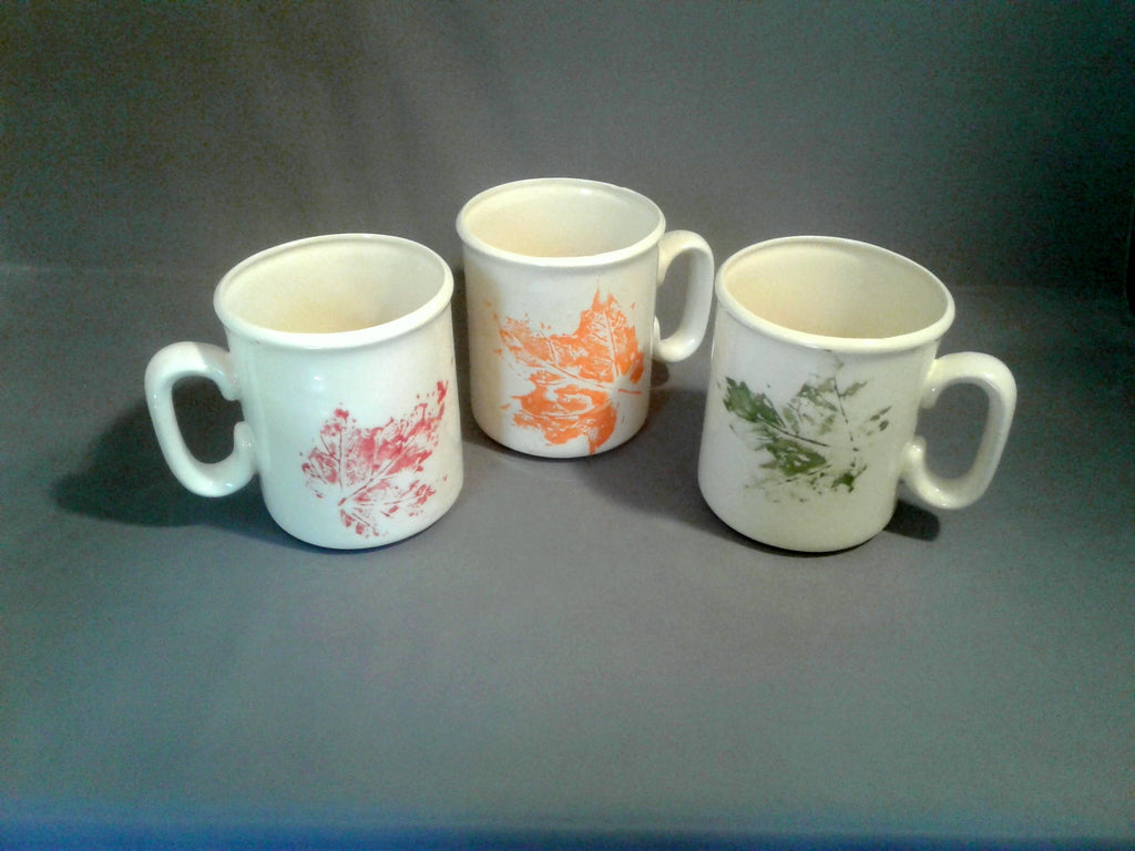 3 large white hand made ceramic mugs with maple leaf glaze print