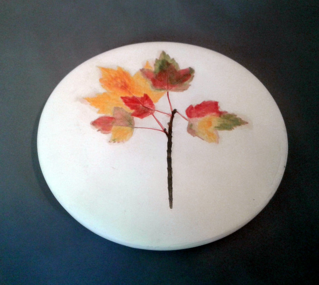 Hand made ceramic trivet with spring of maple leaves