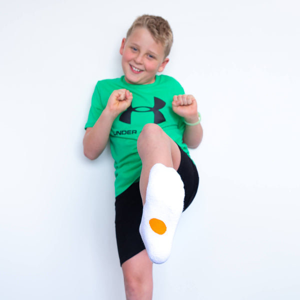 white socks with orange dots for ages 10 plus