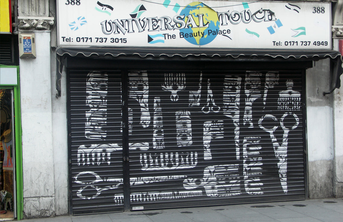 Hairdressing shop and graffiti advertisement, Coldharbour Lane, Brixton, London, UK by Cabinet of Curiosity Studio