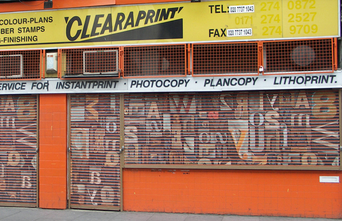 Clearaprint printing shop and graffiti advertisement, Coldharbour Lane, Brixton, London, UK by Cabinet of Curiosity Studio