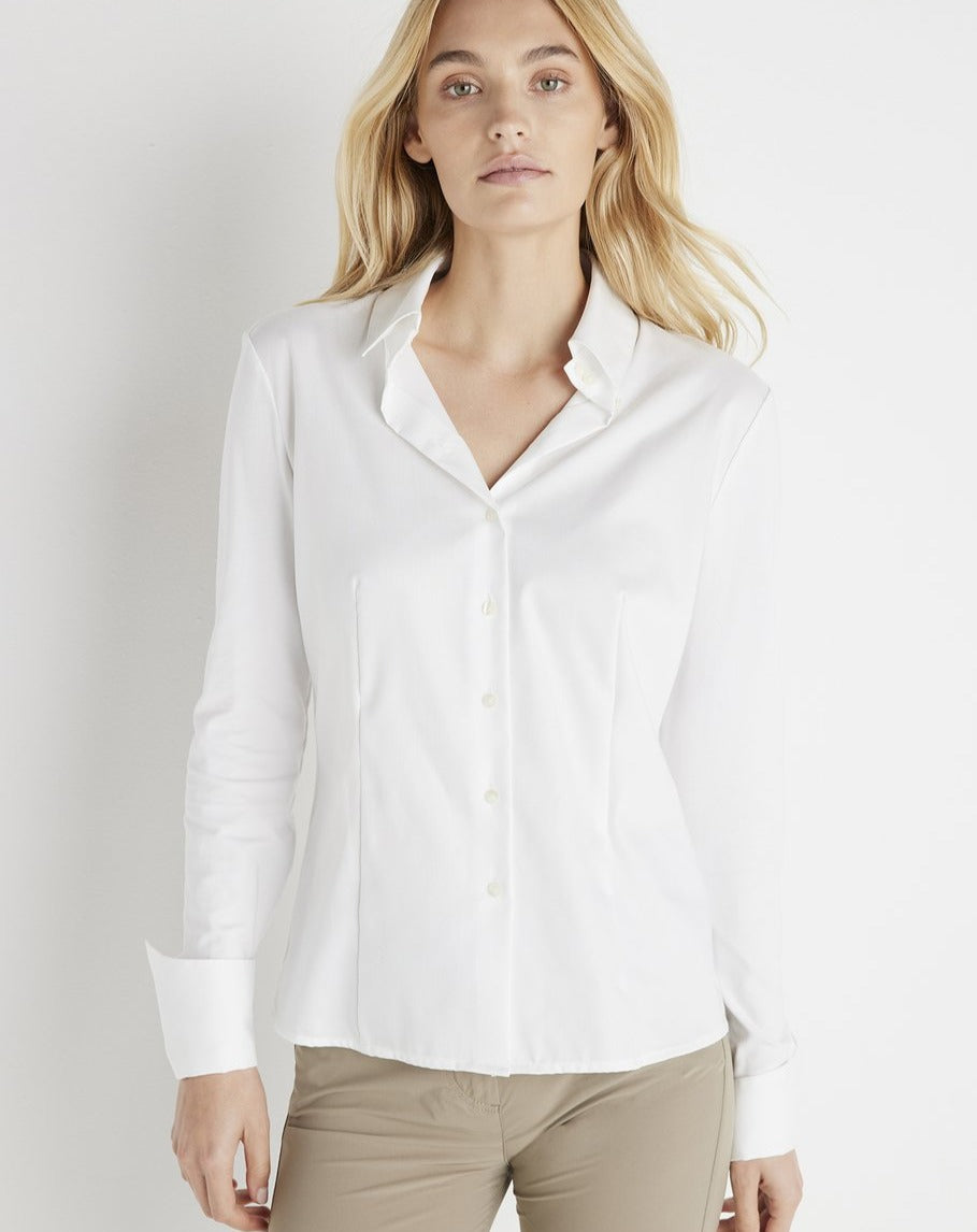 This stylish women's button-up shirt features a crisp white color with a modern slim fit silhouette and flattering designer seaming. A timeless button front-closure and bold menswear-inspired collar add a sophisticated feel to this must-have piece. Crafted using Anatomie's signature wrinkle-resistant fabrics, this essential women's top is perfect for slipping on with any look, from casual and cool to polished and professional.