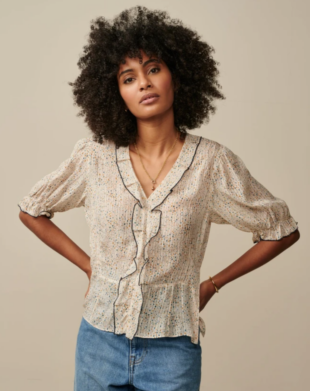 Flecked with a hand-drawn polka dot print, this HESSE blouse brings casual-chic to the table. A retro-slant look crafted from a viscose/silk blend and packed with details such as puffed sleeves, gathered yoke, shaping darts to frame the waistline, and a frilled V neckline.