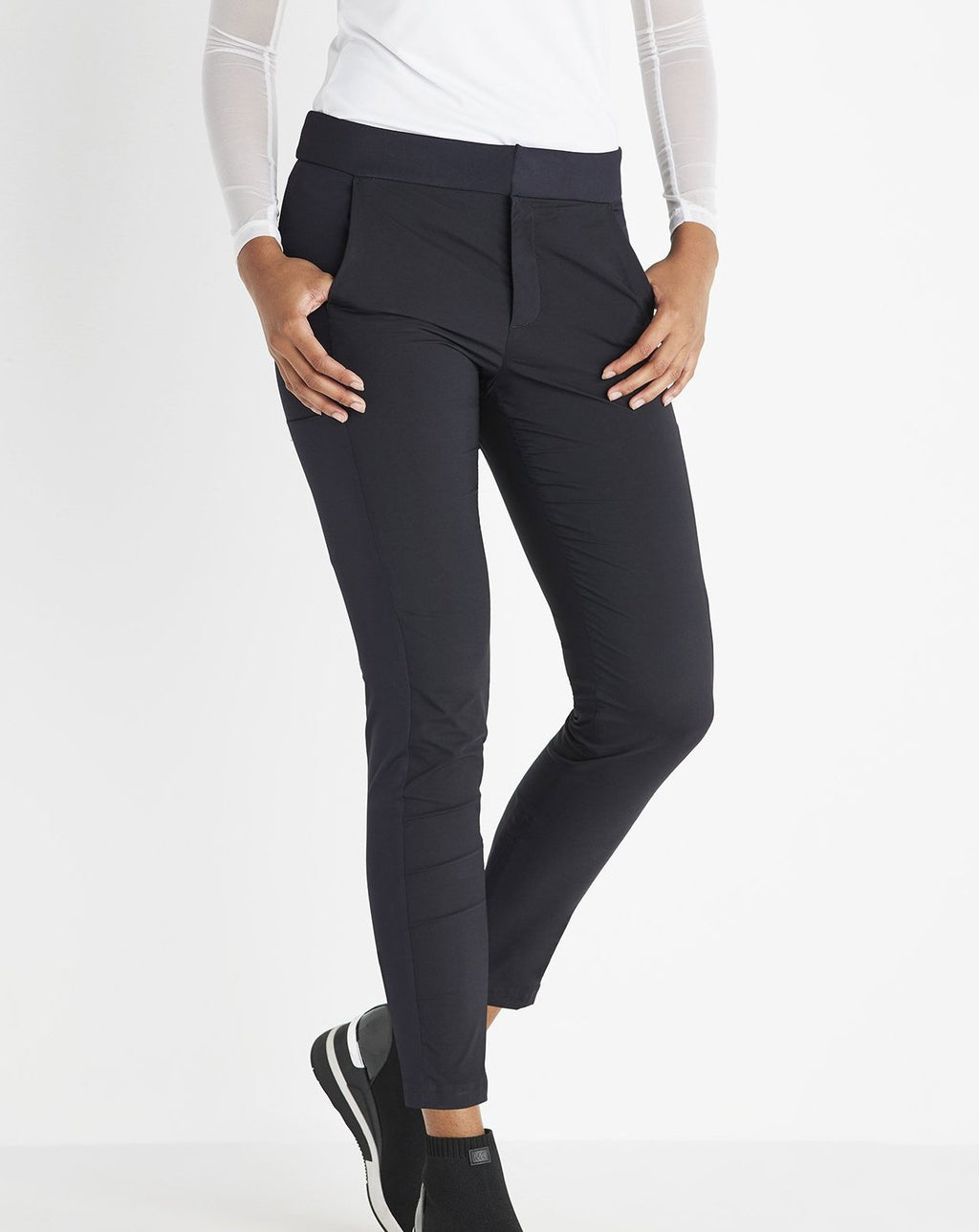 Anatomie ipant in black. Perfect for any traveler who loves the no-fuss quality of leggings but with a dash of refinery.  The Ipant Hybrid Zip Front Slim Fit Pant is the perfect jet-setting essential. This piece is designed with a comfortable zip-front style with high-performance materials and a comfortable spandex and signature stretch blend. Streamlined seams at the front and the back pair perfectly for a travel-ready pant that is perfect for any adventure.
