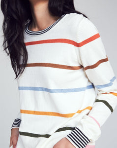 Feel snug as a bug in this ultra soft multi colored sweater.  Made from a luxurious cotton cashmere blend, it features a ribbed crew neck and sleeve cuffs, with a vibrant rainbow stripe print.
