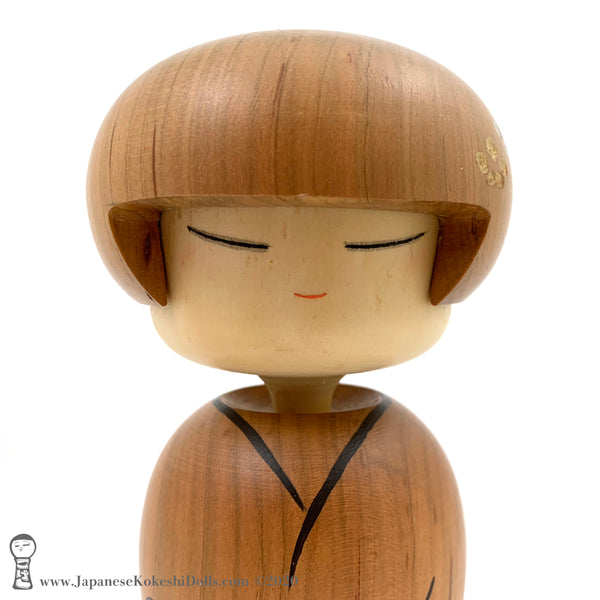 An original, one-of-a-kind modern kokeshi doll by Isao Sasaki. Handmade in early 2020, this doll has sleepy eyes and a calm expression. Carved from premium hardwood with beautiful woodgrain.