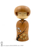 A one-of-a-kind sosaku kokeshi doll by Isao Sasaki. Hand-crafted in early 2020, this doll has sleepy eyes and a calm expression. A beautiful Japanese wooden doll made from premium hardwood with beautiful woodgrain.