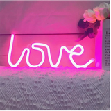 Add character to your space with this neon led love word light, a simple interior design aesthetic to make your space pop
