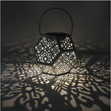 A solar powered pattern light can be used indoors or outdoors. The light and shadow patterns will instantly breathe magic into any space they are placed.