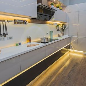 Popspace Vibe Lights are easy to install LED light strips to light any space, like this under cabinet and under counter light strip lighting to set a nice elegant vibe in your kitchen. Easily operated by remote.