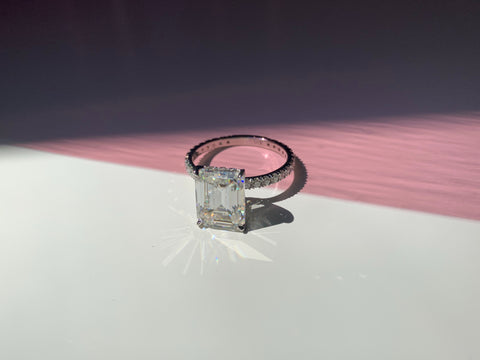 4 carat emerald cut Moissanite ring with infinity band and hidden halo by Jennifer Hillyer Jewelry