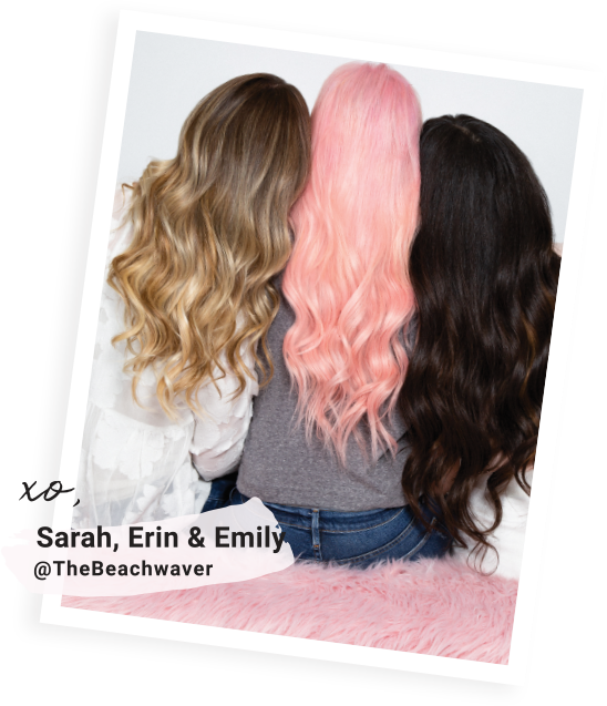 Photo of our founders back view, Sarah with pink hair, Erin with brunette hair and Emily with blonde hair.