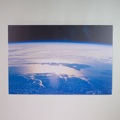 A printed infrared heating panel with an image of the earth.