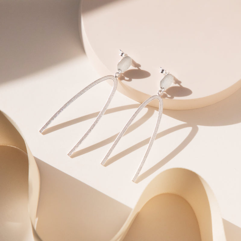 Oval Disc and Arc Wave Drop Earrings