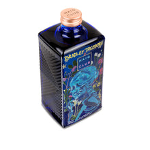 Load image into Gallery viewer, Bradley Theodore Artist Series Haig Club Clubman bottle with Field Of Flowers artwork from top down angle.