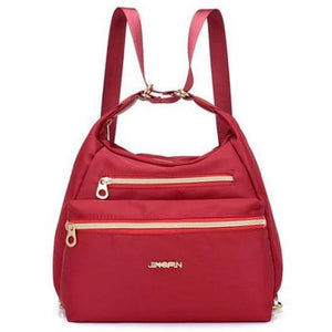 Red nylon crossbody convertible bag
