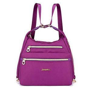 Purple nylon crossbody convertible bag