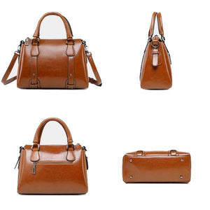 Brown leather purse with top handles