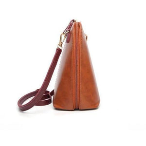 Wide opening leather handbag