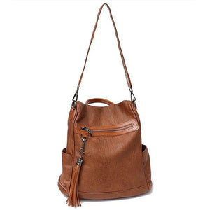 leather brown backpack with shoulder strap