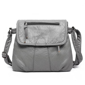 Gray leather flap bag with triple compartment