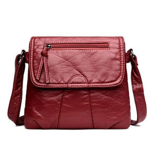 Red leather flap bag with triple compartment