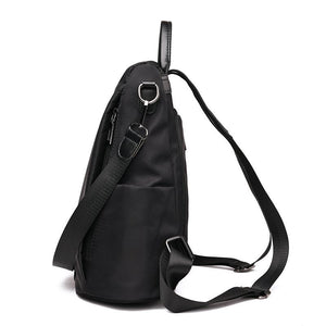 Anti-theft travel backpack with side bottle holder